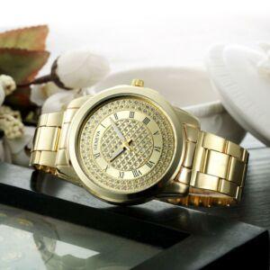 Geneva kristályokkal kirakott női karóra, arany