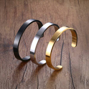 Nemesacél nyitott karperec, arany, ezüst és fekete, átmérő 6,4 cm