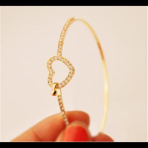 Szív motívumos karperec, arany színű