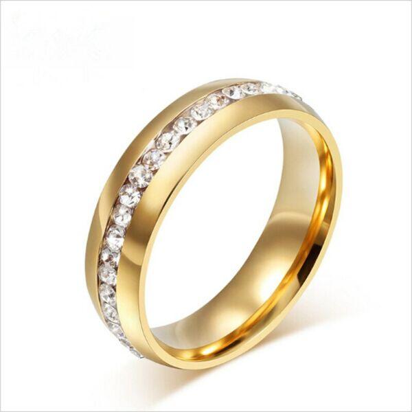 Egysoros nemesacél kövekkel kirakott arany színű gyűrű több méretben